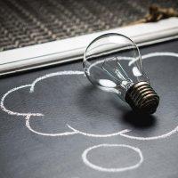 Lightbulb on chalkboard